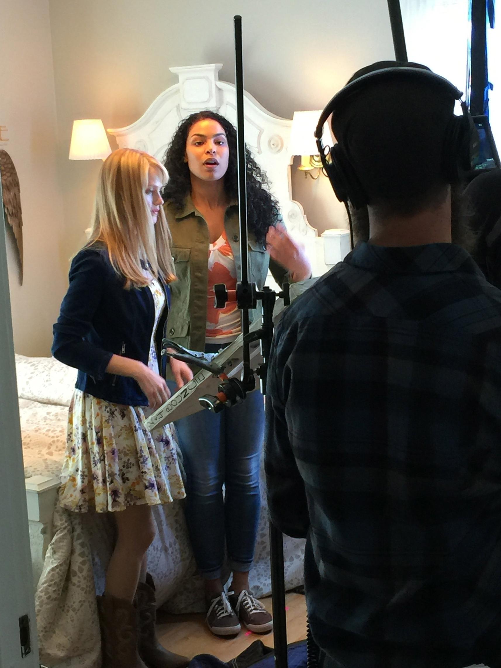 Lindsay Pulsipher & Jordin Sparks practice for a scene take on set.