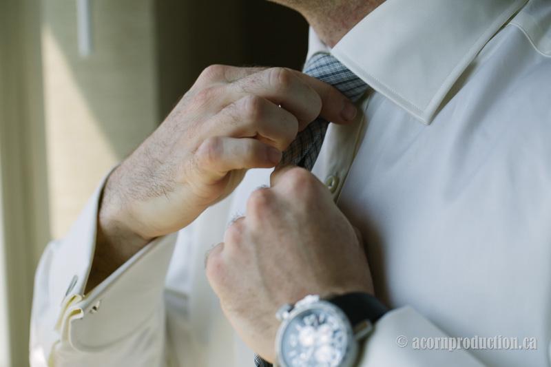 02-groom-fixing-his-tie