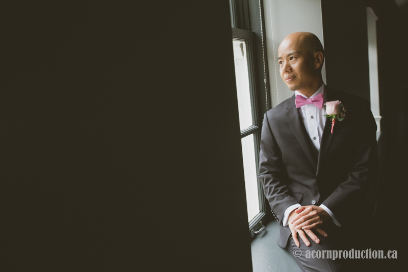 46-groom-looking-out-window-sunnybrook-wedding