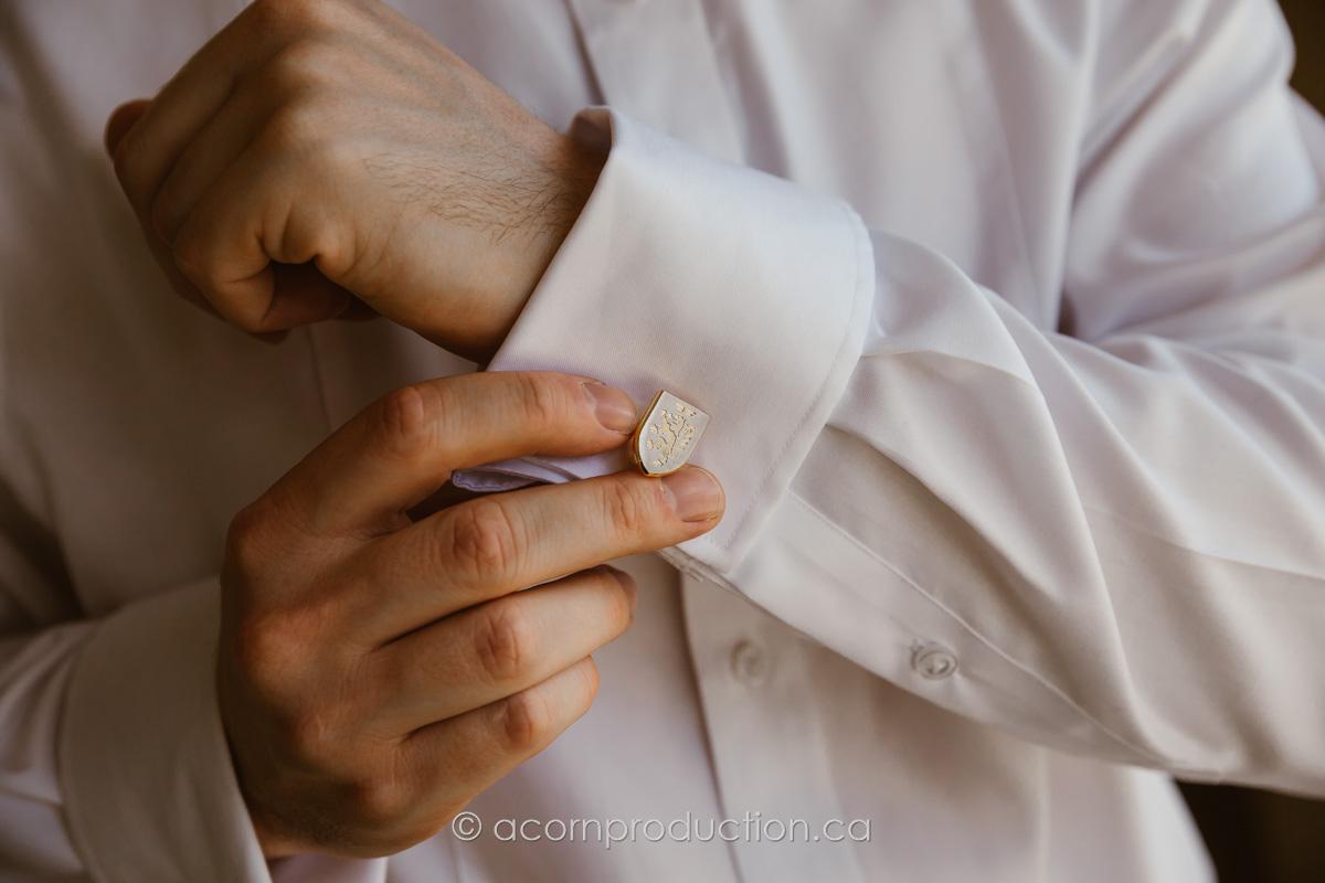 groom-putting-cuff-links