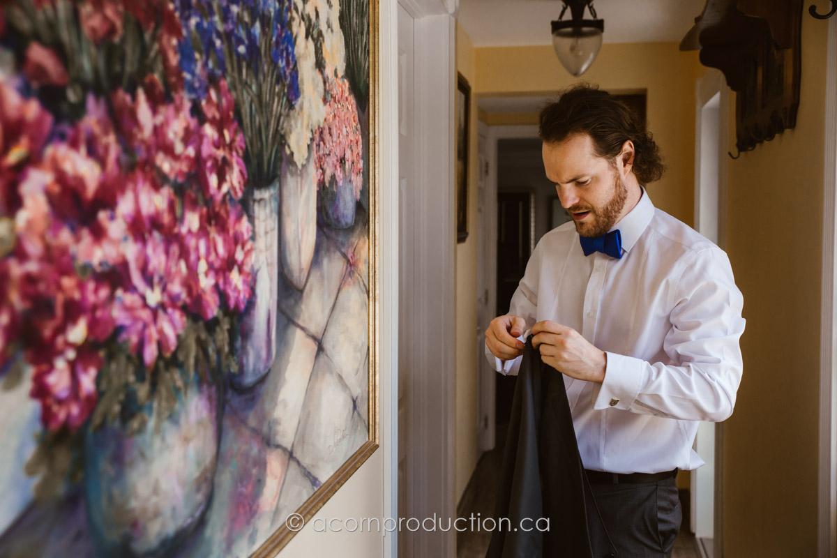groom-putting-vest-on