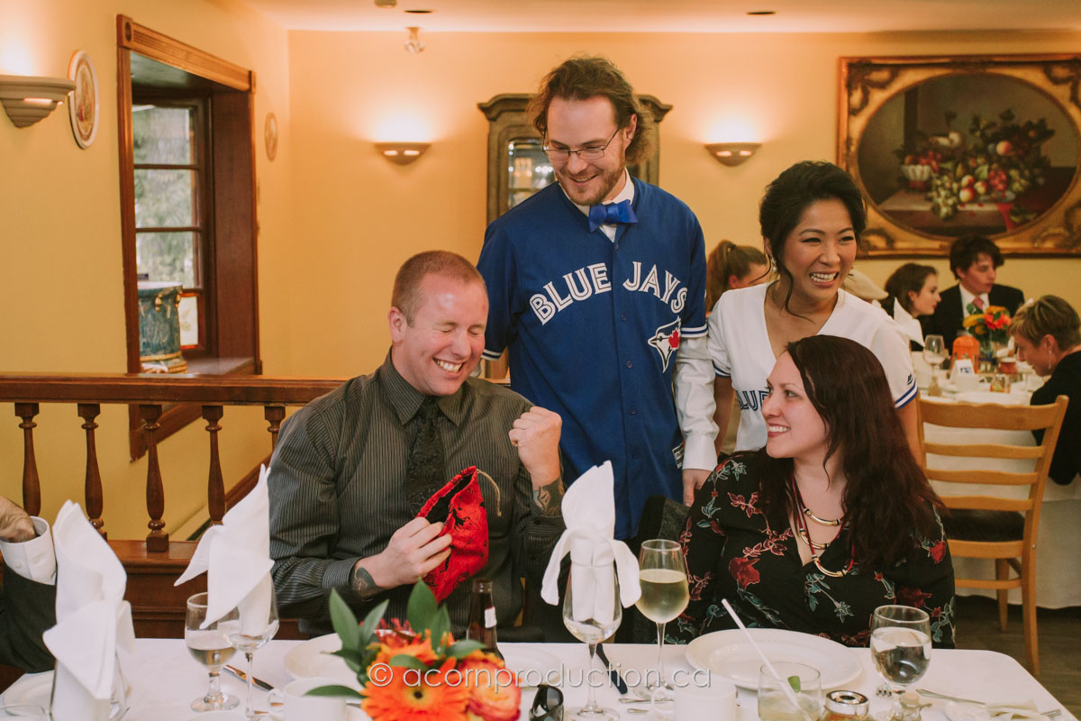 wedding-couple-wearing-blue-jays-jersey