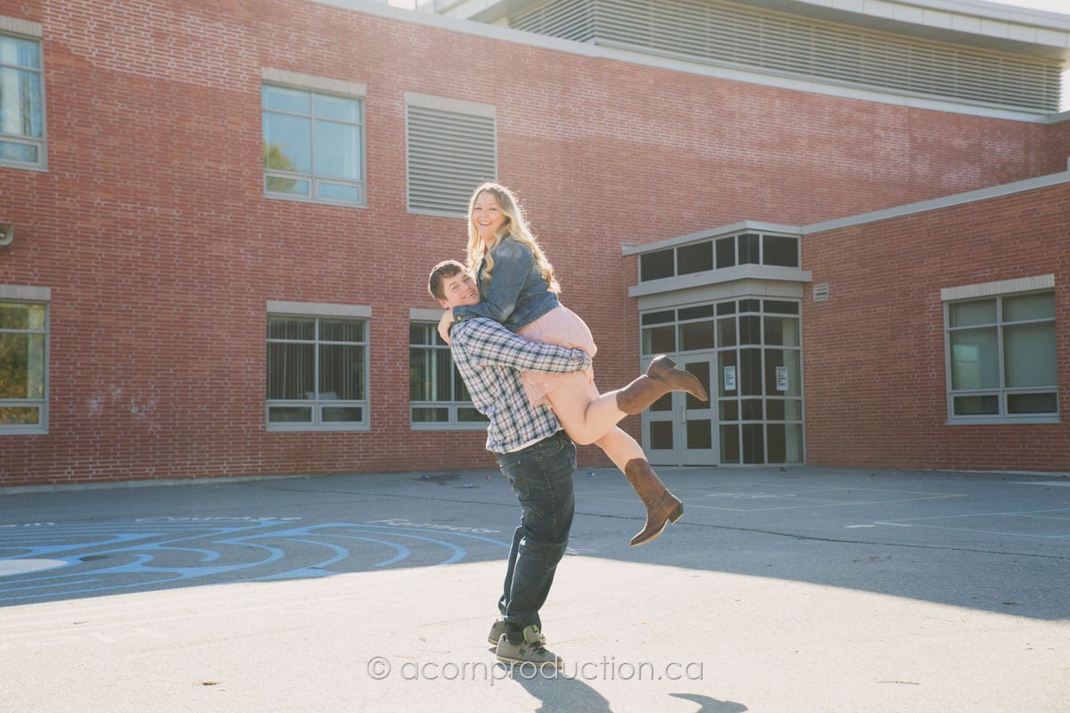 man-lifting-woman-engagement-photo-session