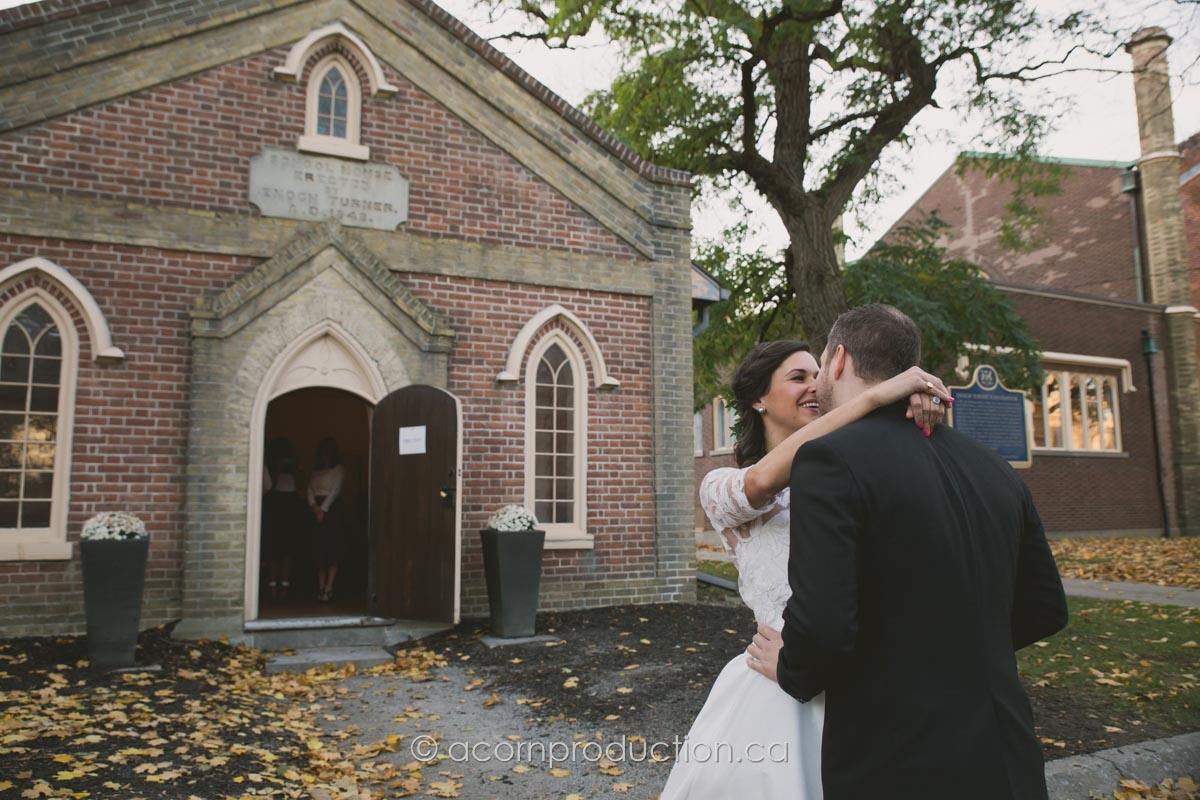 bride and groom first look kiss