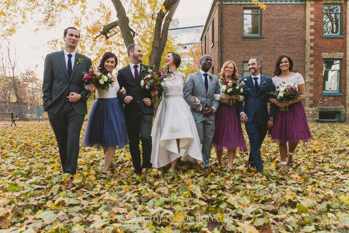 wedding party walk across dried leaves