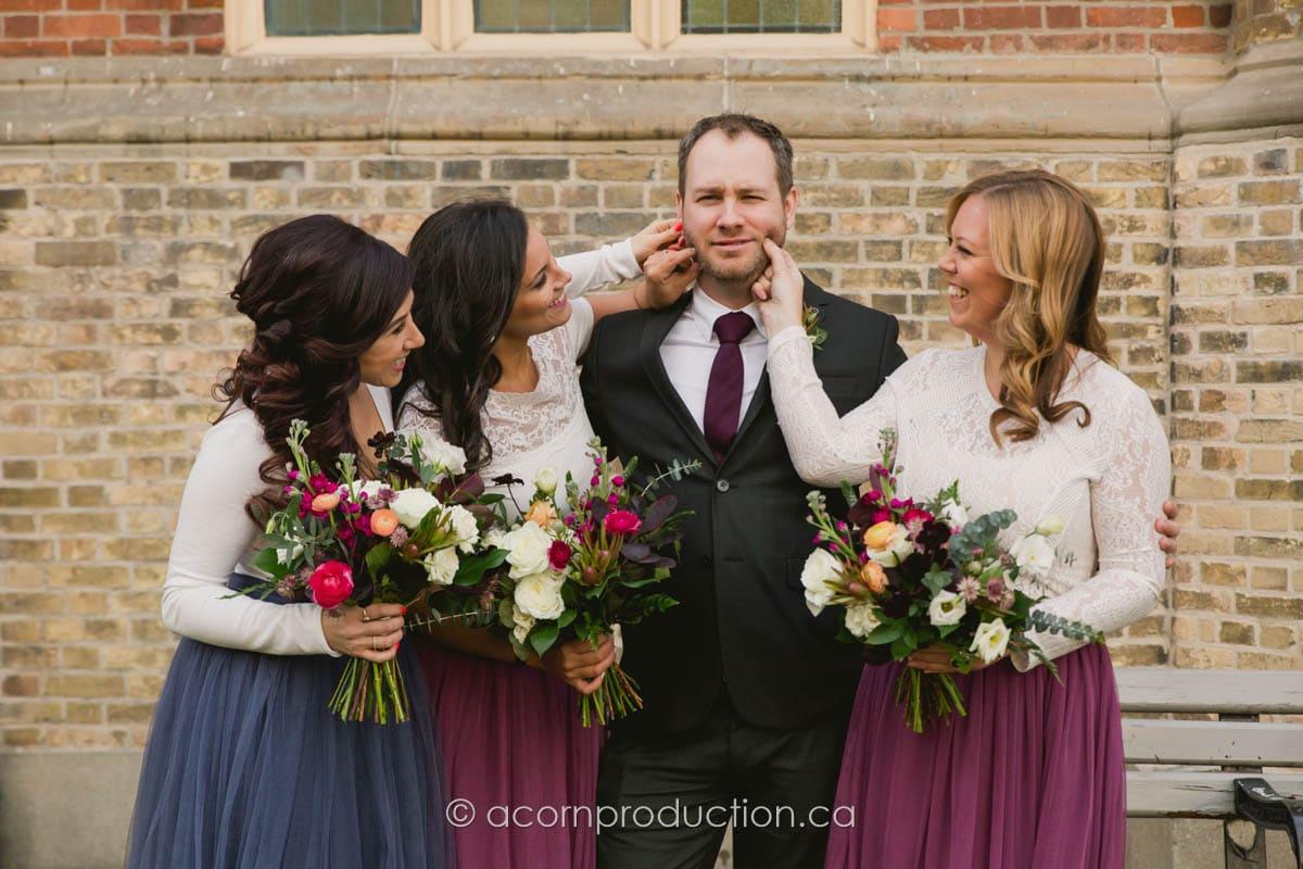 bridemiads pinching groom face