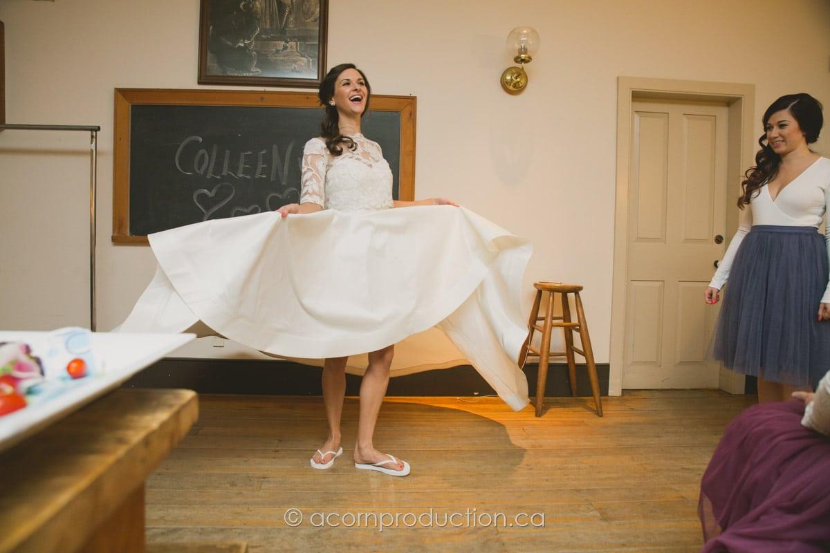 bride swinging her dress inside enoch turner schoolhouse