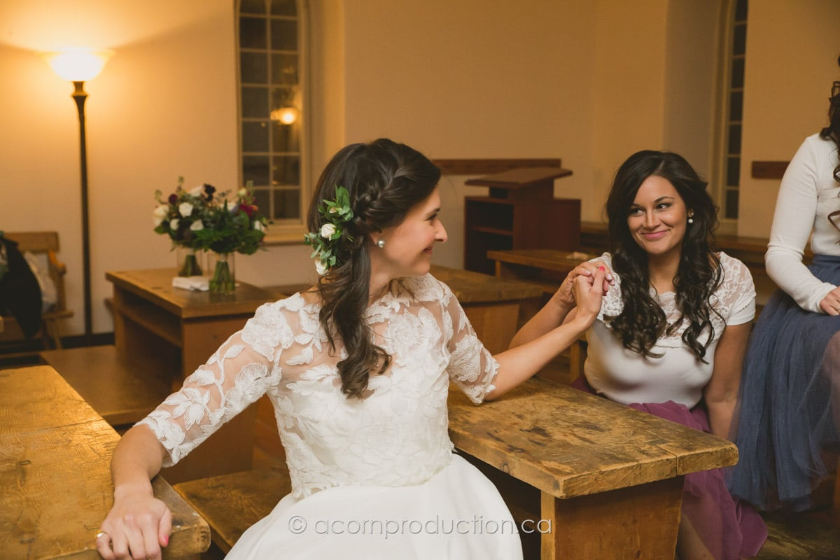 bride and bridesmaid holding hands