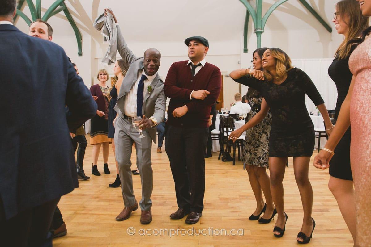 wedding guests having a good time inside enoch turner schoolhouse