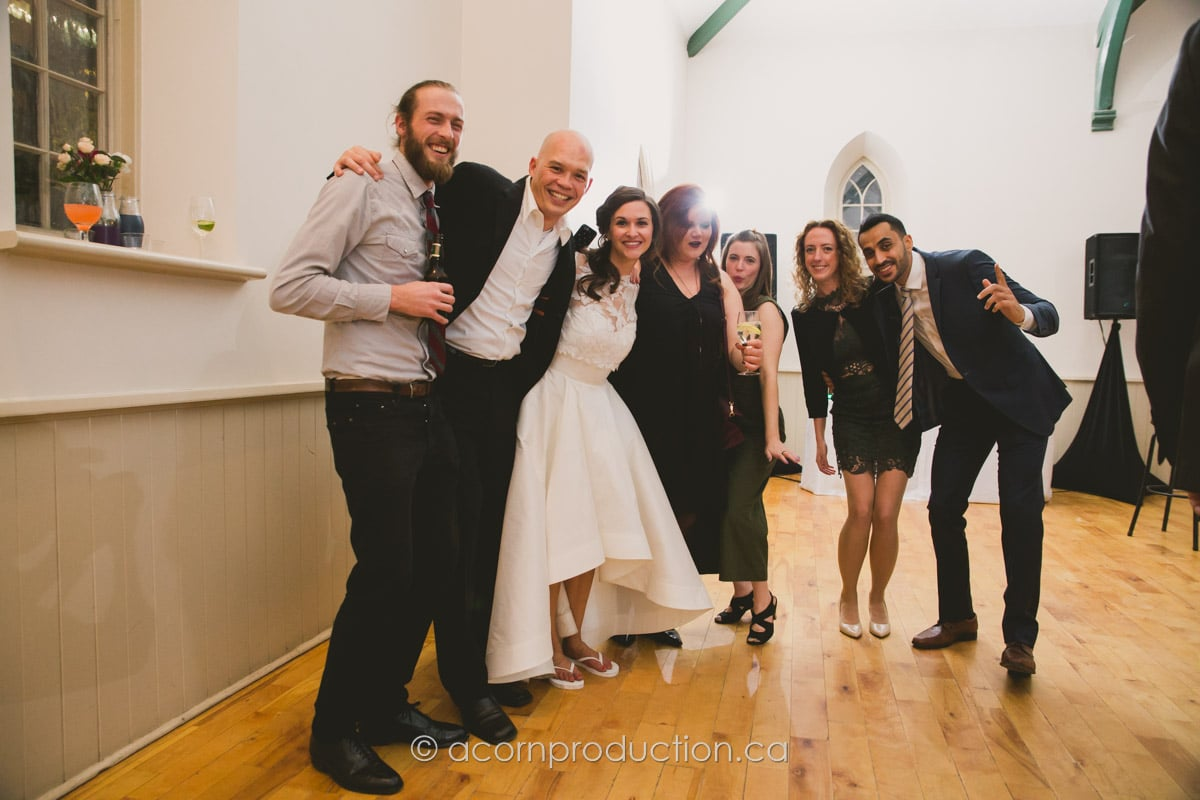 wedding guests posing for photo inside enoch turner schoolhouse