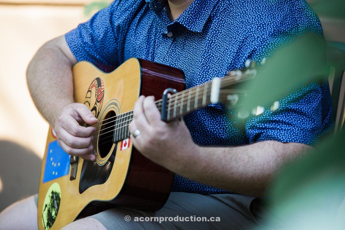man-playing-music-during-wedding-cermony.jpg