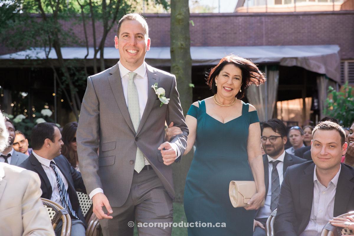 groom-walking-in-with-mom.jpg
