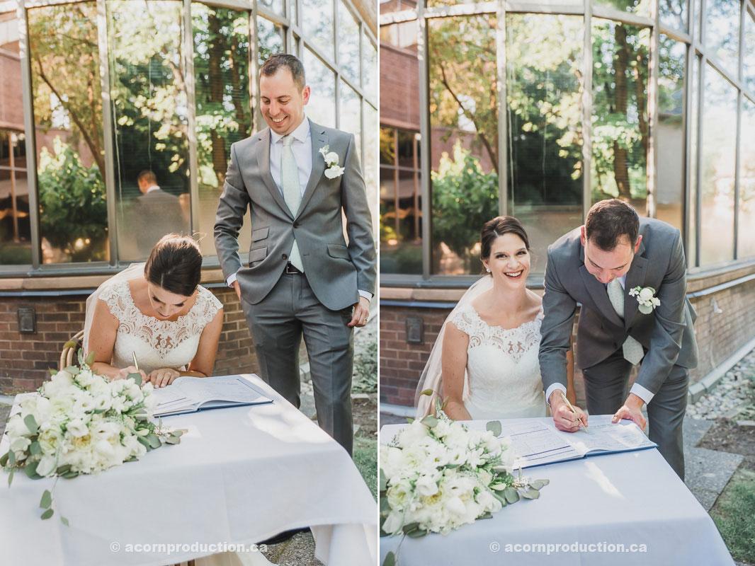 toronto-granite-brewery-wedding-bride-and-groom-signing-marriage-license.jpg