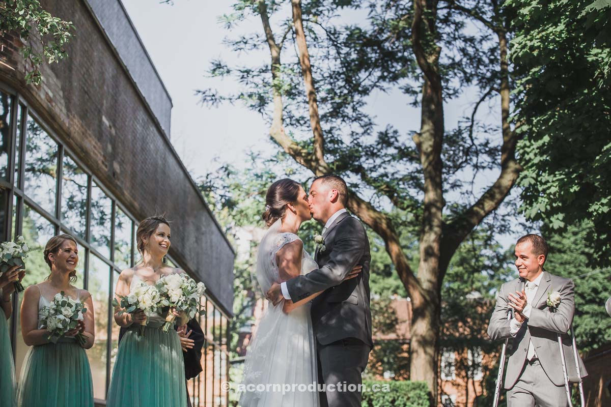 toronto-granite-brewery-wedding-cermony-bride-and-groom-kissing.jpg