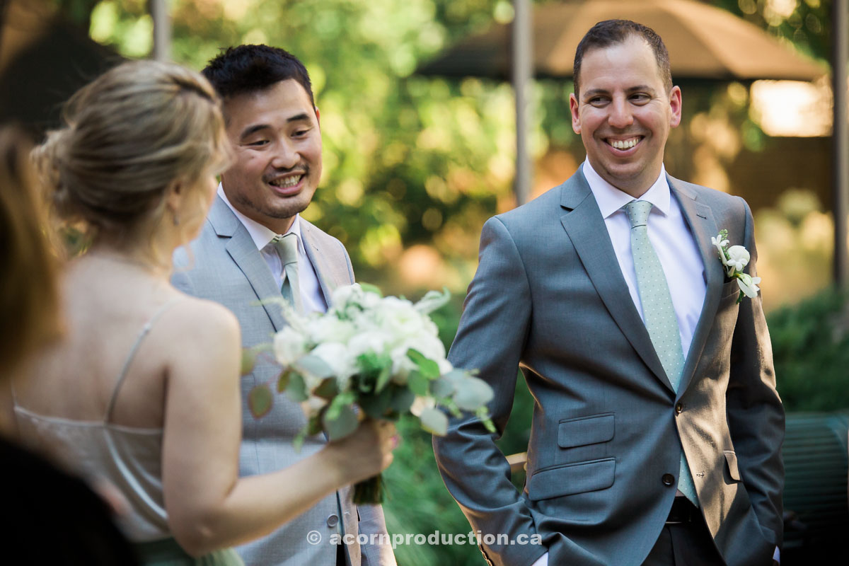 groom-chatting-with-wedding-party.jpg