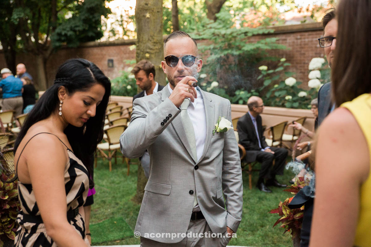 wedding-guest-smoking-cuban-cigar.jpg