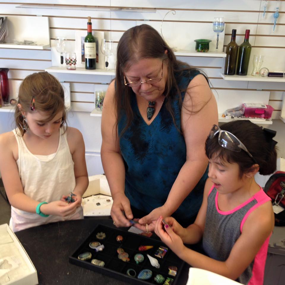 Linda L. Sweeney sharing the love of glass beads with the next generation!