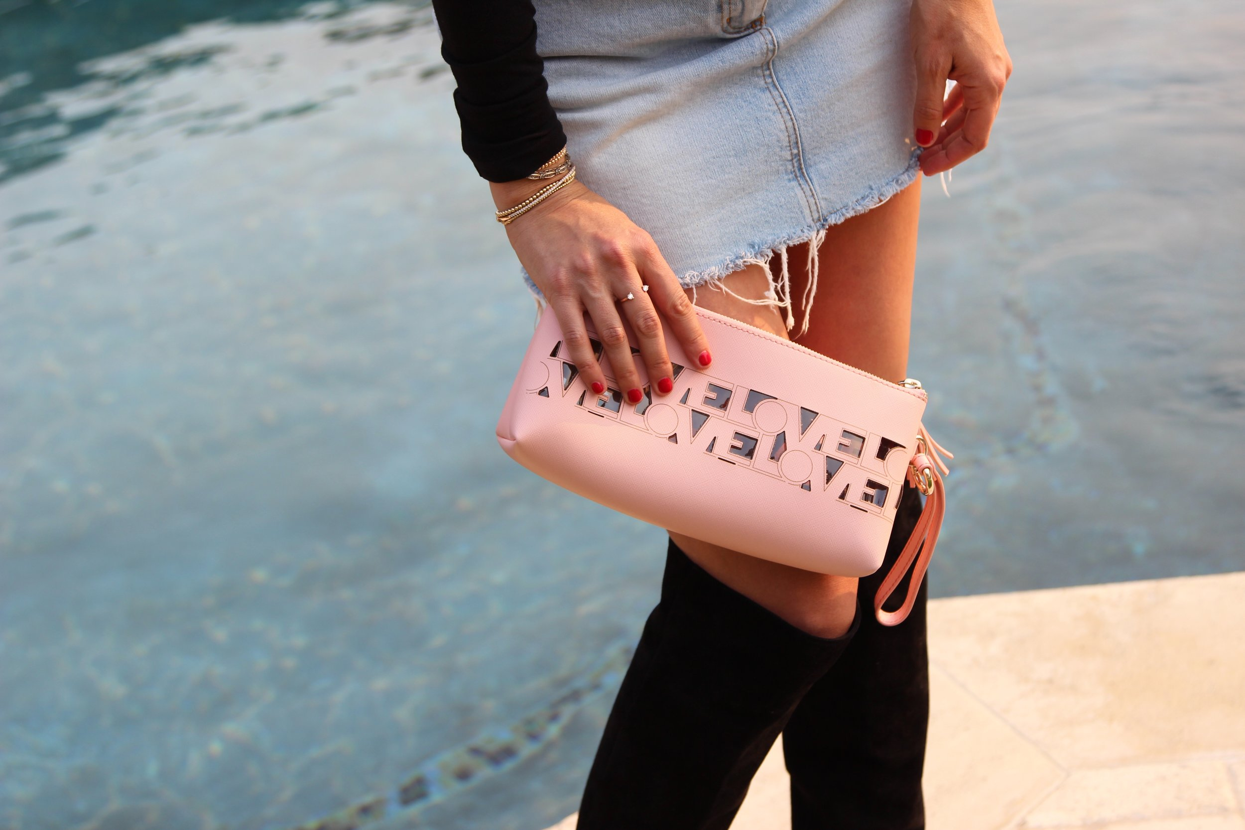 Holding Pink Clutch.jpg