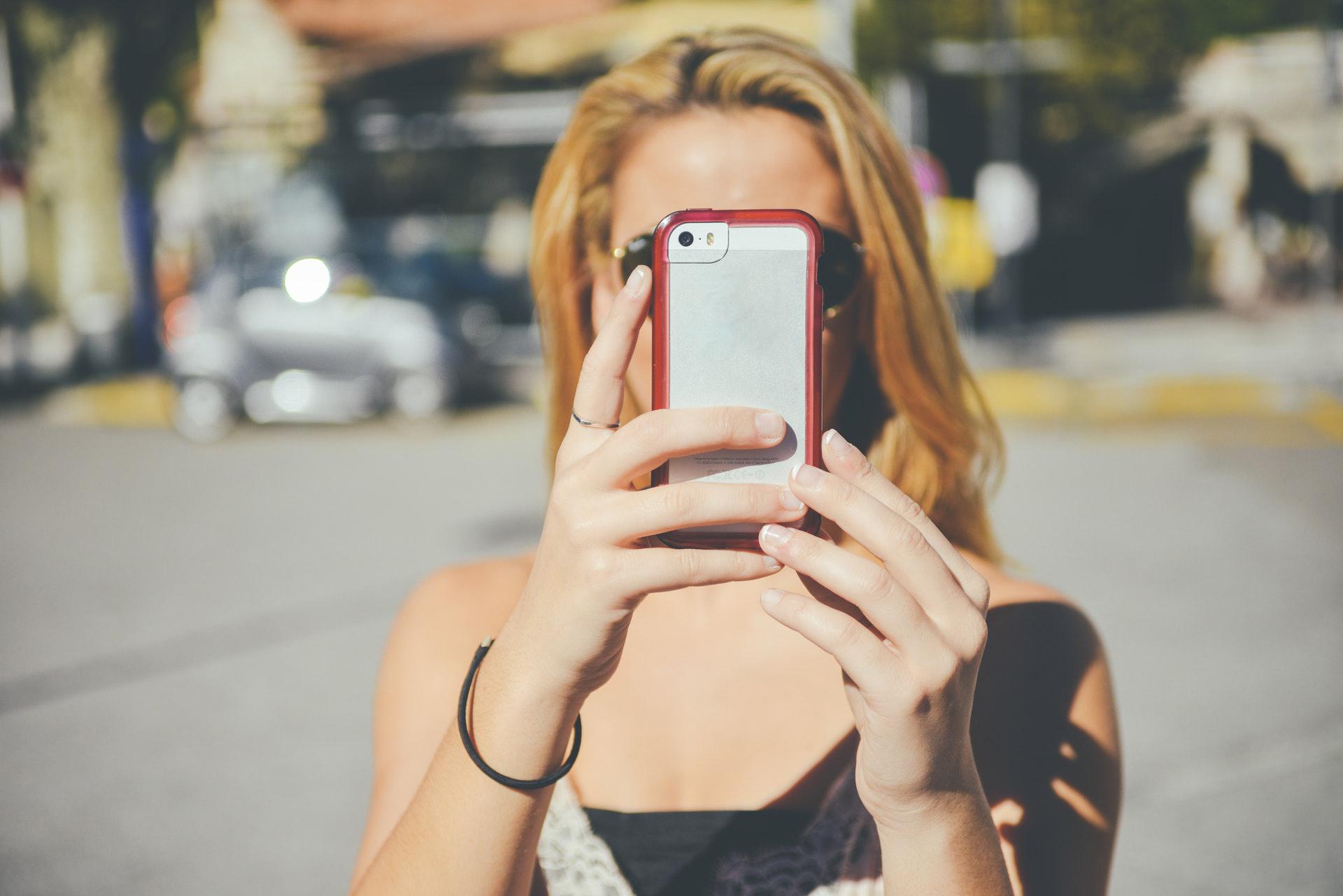 woman filming on phone.jpg
