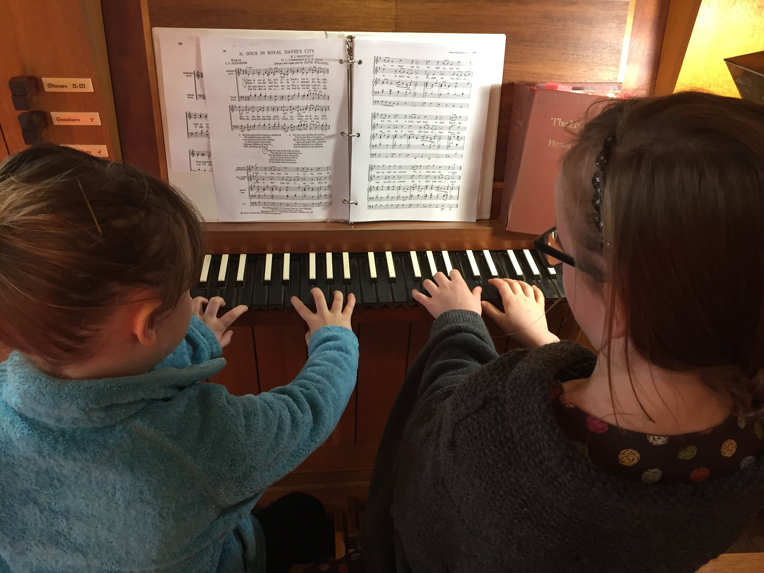 Young parishioners explore our pipe organ.