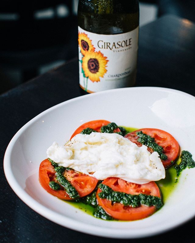 Pressing reset from yesterday's burgers and dogs with fresh juicy tomatoes, tangy burrata and bright herby pesto.⠀⠀⠀⠀⠀⠀⠀⠀⠀ -⠀⠀⠀⠀⠀⠀⠀⠀⠀ -⠀⠀⠀⠀⠀⠀⠀⠀⠀ -⠀⠀⠀⠀⠀⠀⠀⠀⠀ #burrata #pesto #freshbasil #tomato #chardonnay #isolapizzabar #sandiegoeats #freshfood #healthyeats