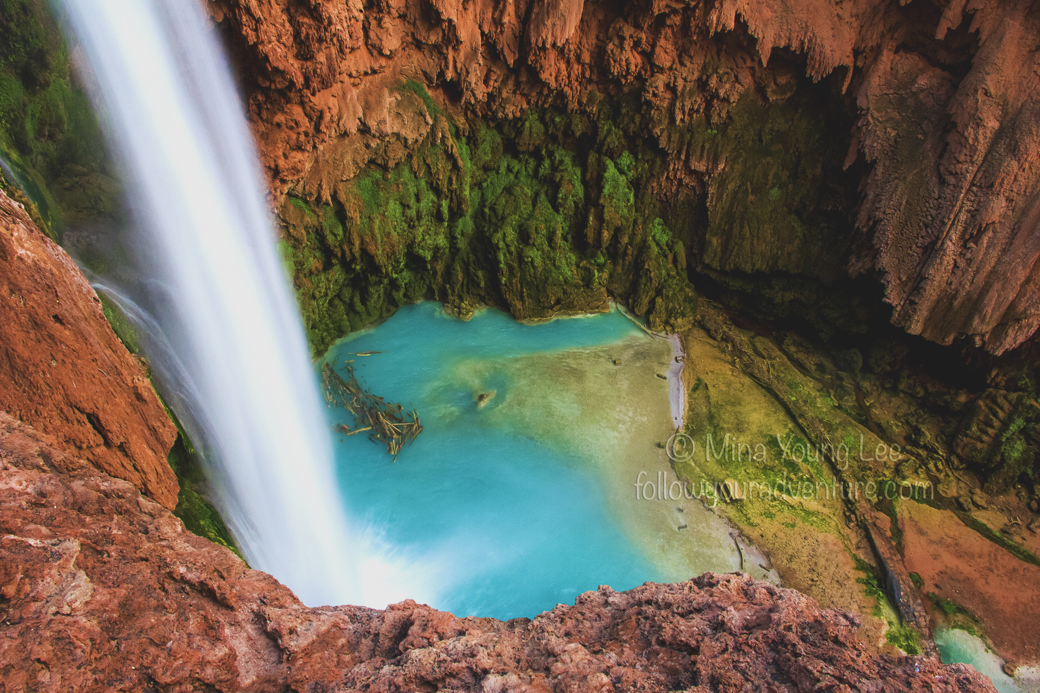The debris at the bottom of Mooney Falls is a result of past flash floods  Photograph by Mina Young Lee
