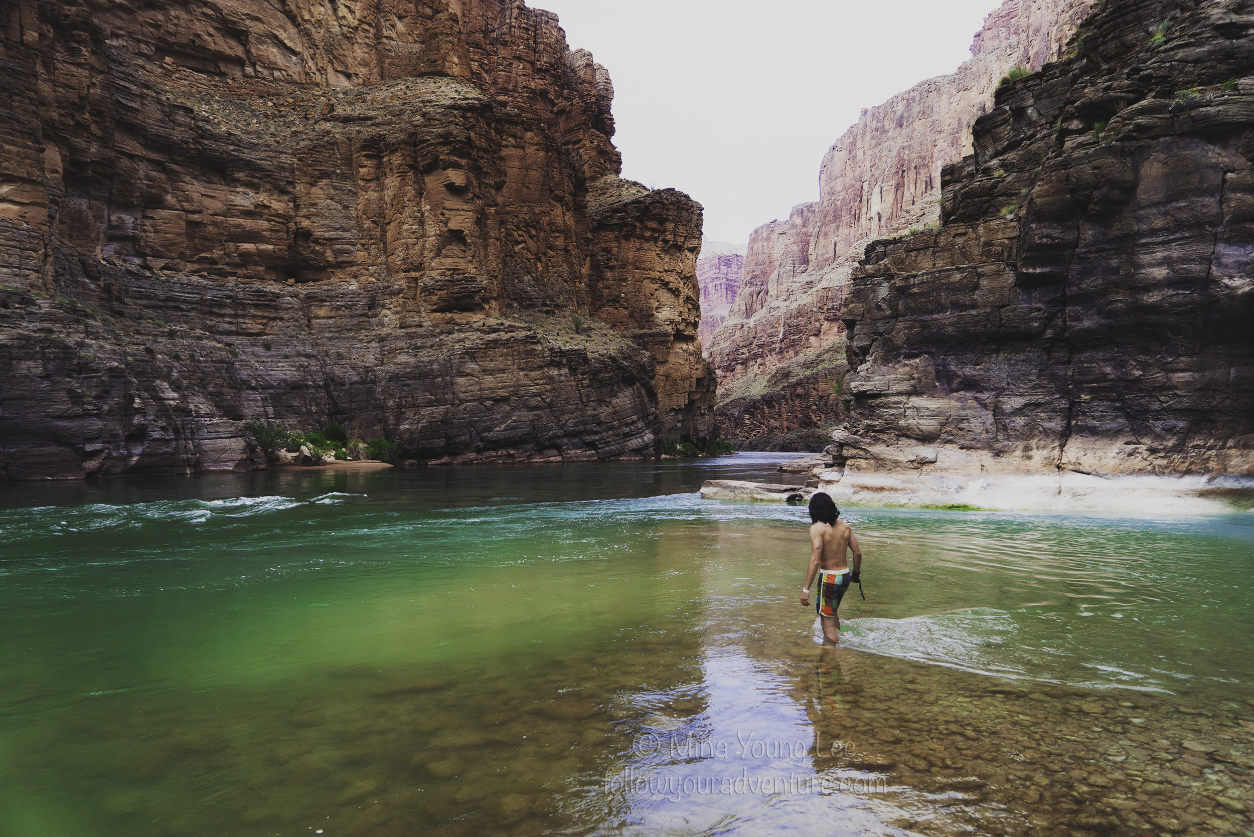 Adventurer Nick cools off in the river where Havasu Creek meets the Colorado River  Photograph by Mina Young Lee
