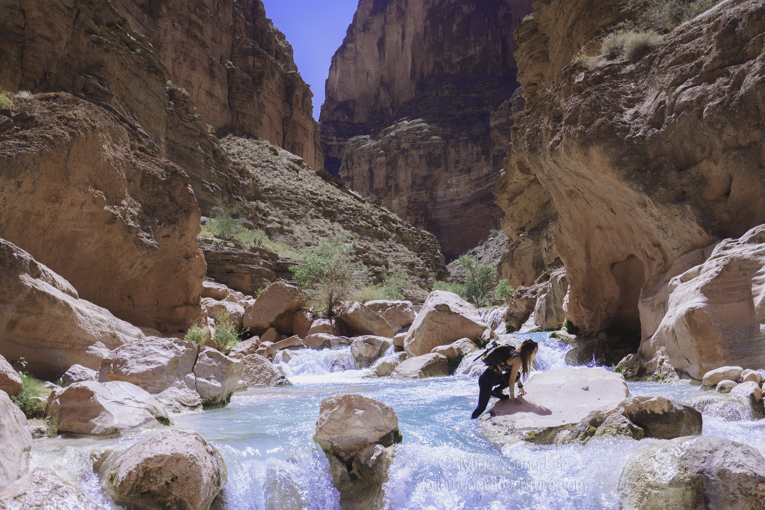 Adventurer Mina crosses the river along the trek to the Colorado River  Photograph by Juuso Ringman and Mina Young Lee