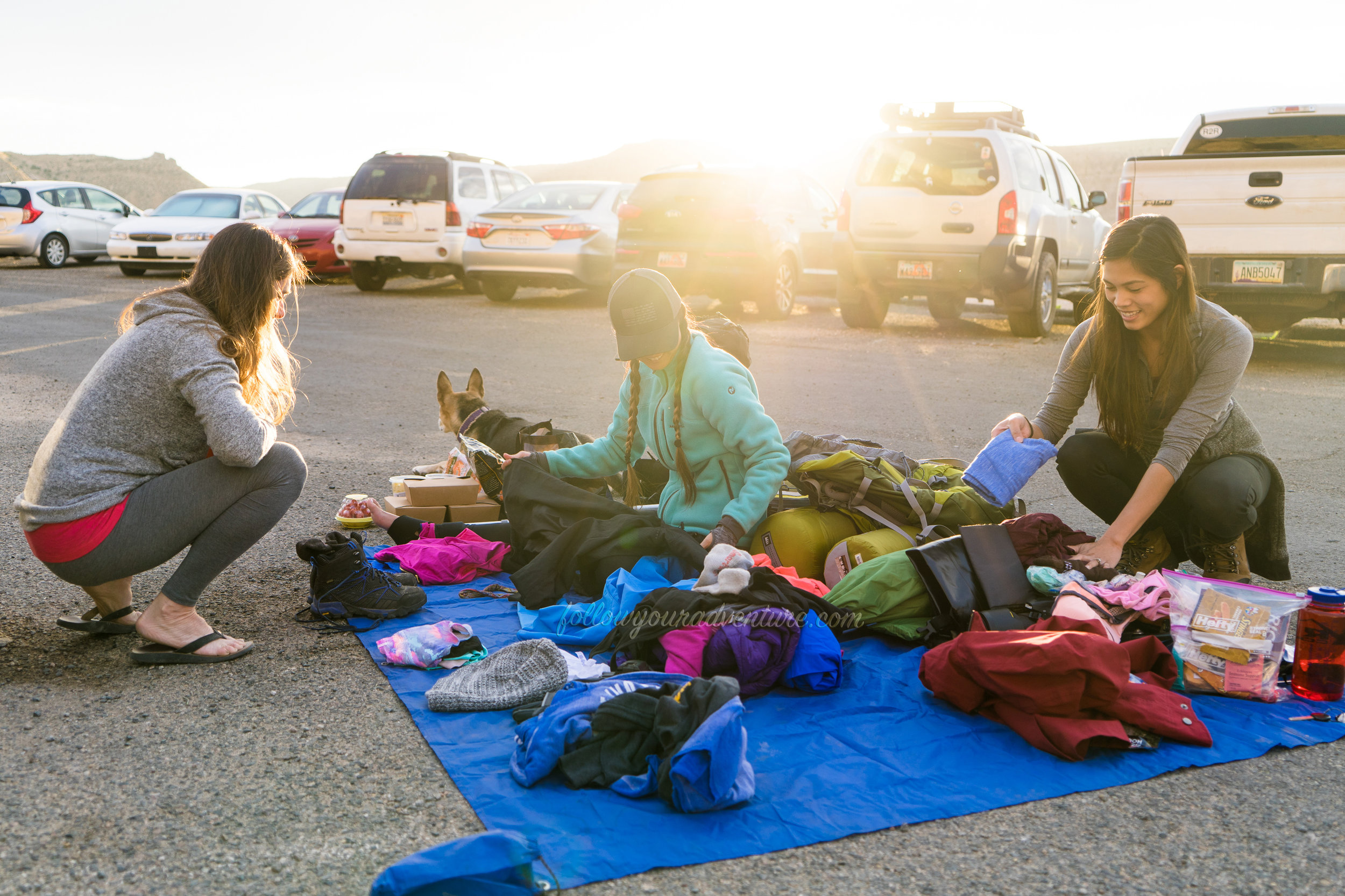 Mina helping first-timers Rhonda and Diana pack for Havasupai at the Hualapai Hilltop parking lot  Photograph by Juuso Ringman