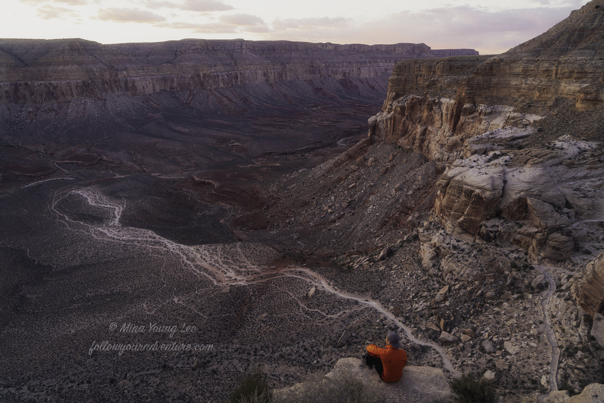 Hiker James looking out over the canyon from the Hualapai Hilltop parking lot  Photograph by Mina Young Lee