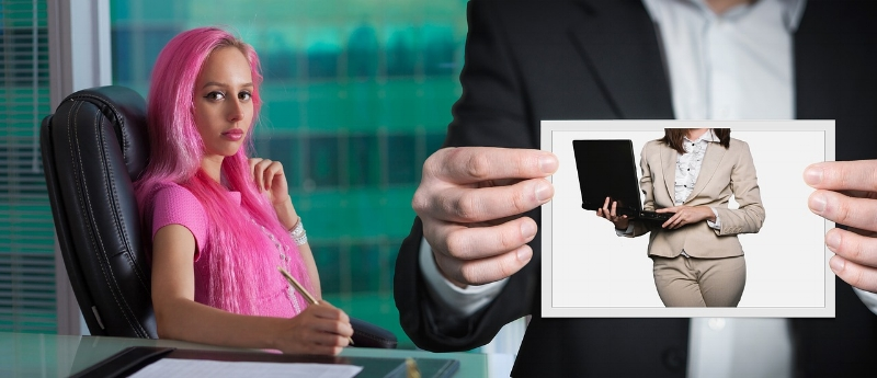 I swear that I was just looking for a picture of someone in a nice suit, and came across this beauty of a stock photo that I just had to use.The woman in pink is poised to write with a pen onto a glass topped table, nowhere near the paper... a random, faceless, generic person in the foreground is holding up a picture of a random, faceless woman in a beige suit holding a generic laptop??? WHAT IS HAPPENING HERE?????