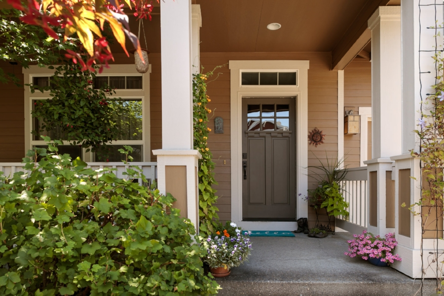 Newer exterior paint and established landscape make the entry a showpiece