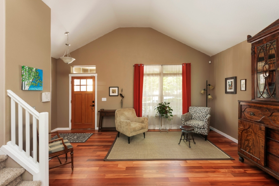 Step into the vaulted living room and enjoy the newly refinished custom eucalyptus floors.