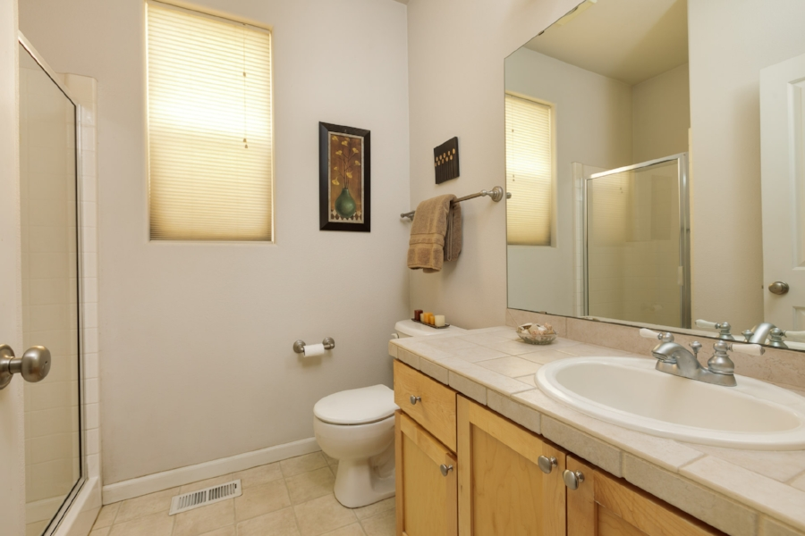 Also, on the main floor next to the extra bedroom, you'll find a full bathroom with a shower.