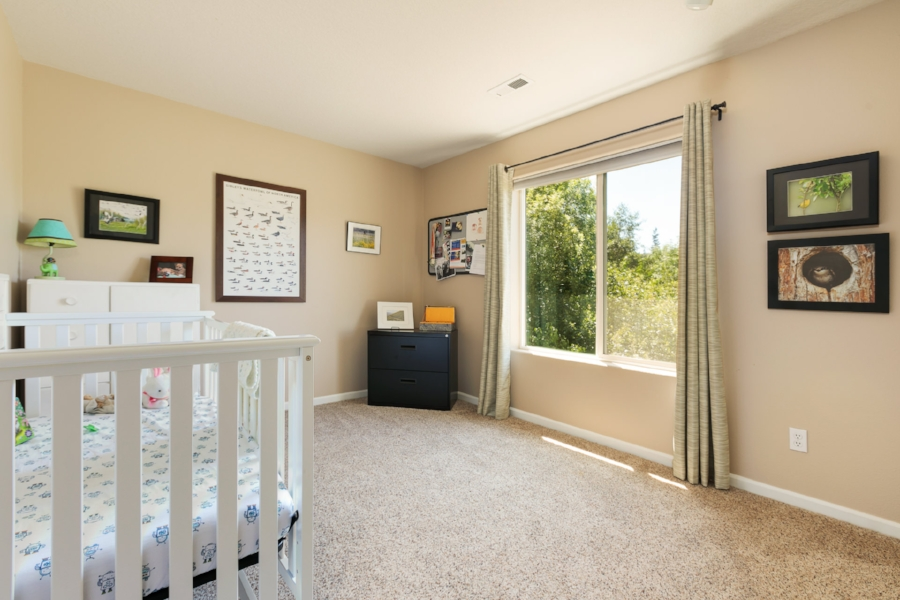 Another generous-sized bedroom upstairs overlooks the nature park.