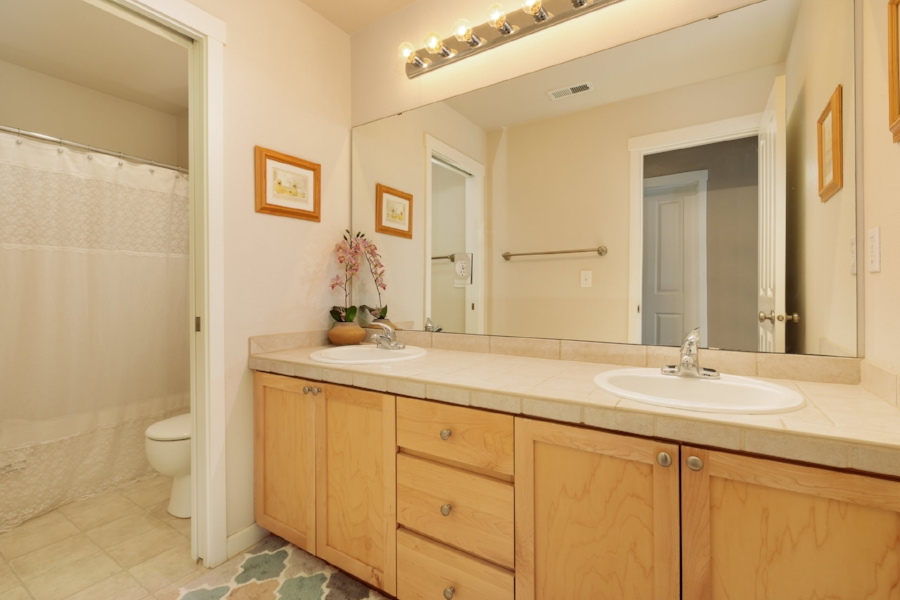 The hallway bathroom also has a double vanity and separate tub/shower.