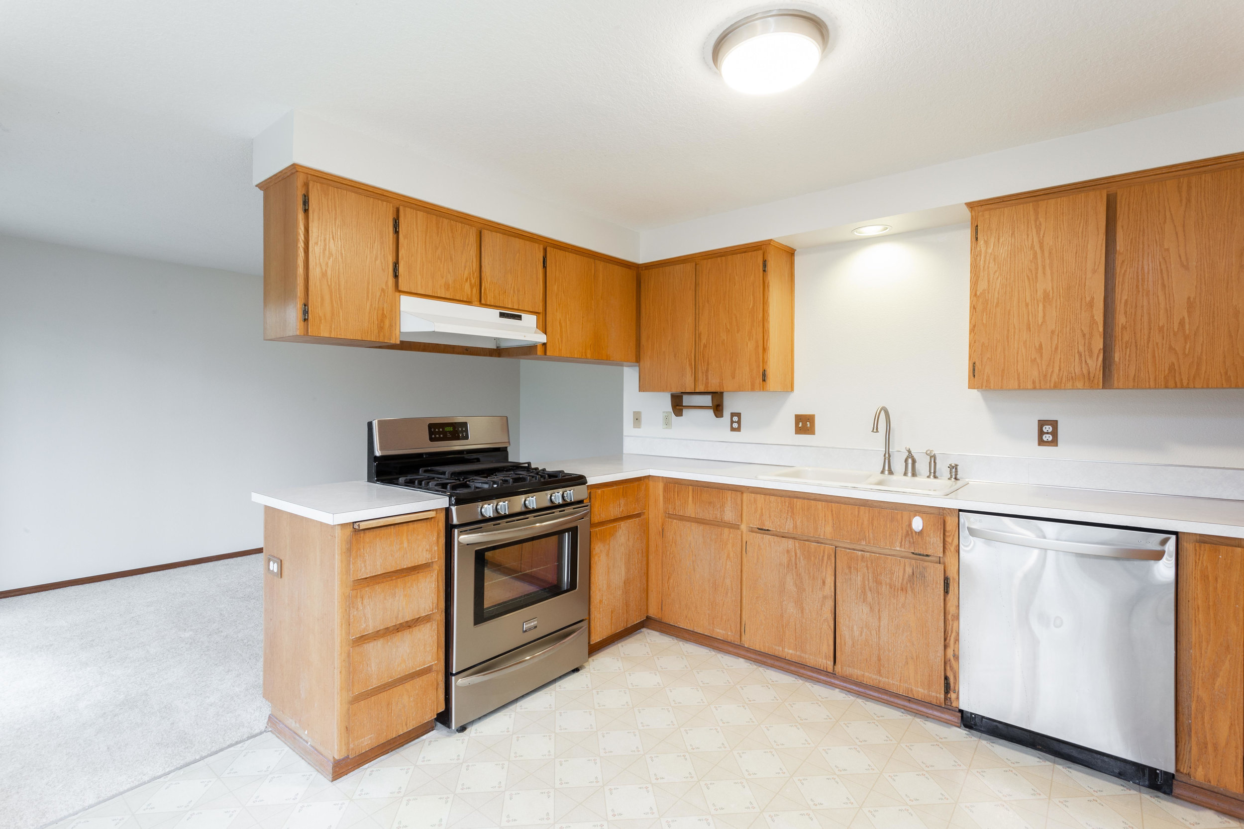 Large kitchen with breakfast nook open to the back family room. New stainless steel dishwasher and gas stove