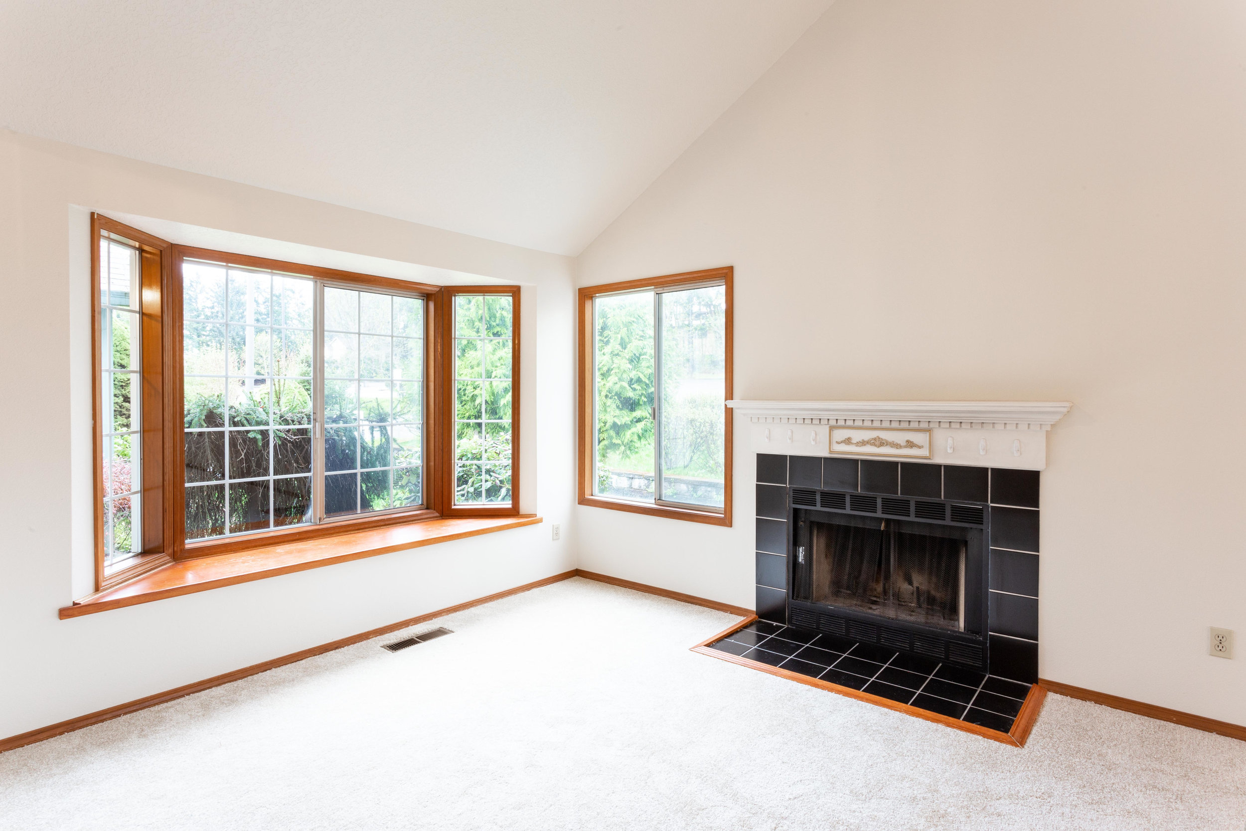 Who can resist a window seat next to a fireplace?