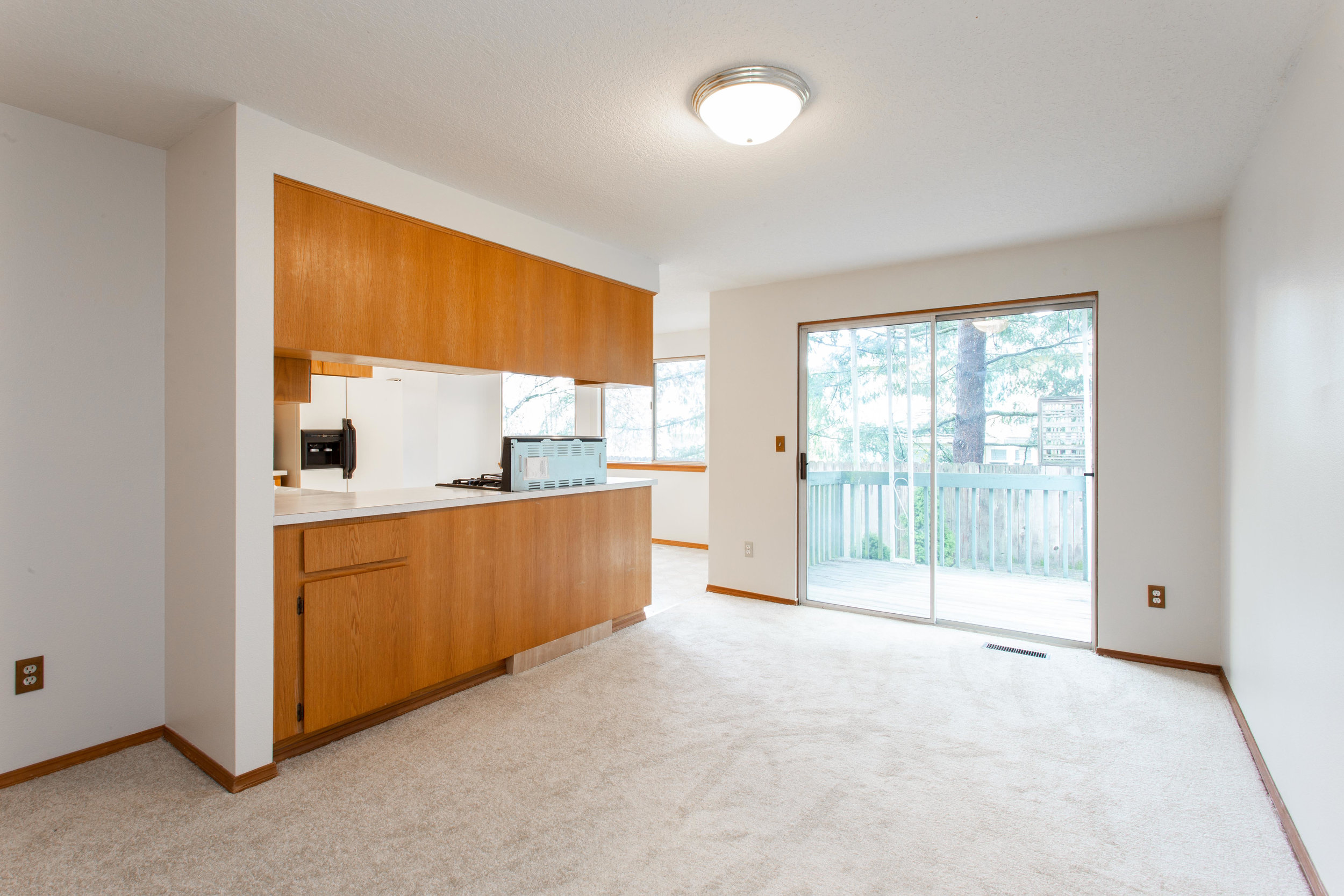 Kitchen looks onto the family room and a sliding glass door connects to the…