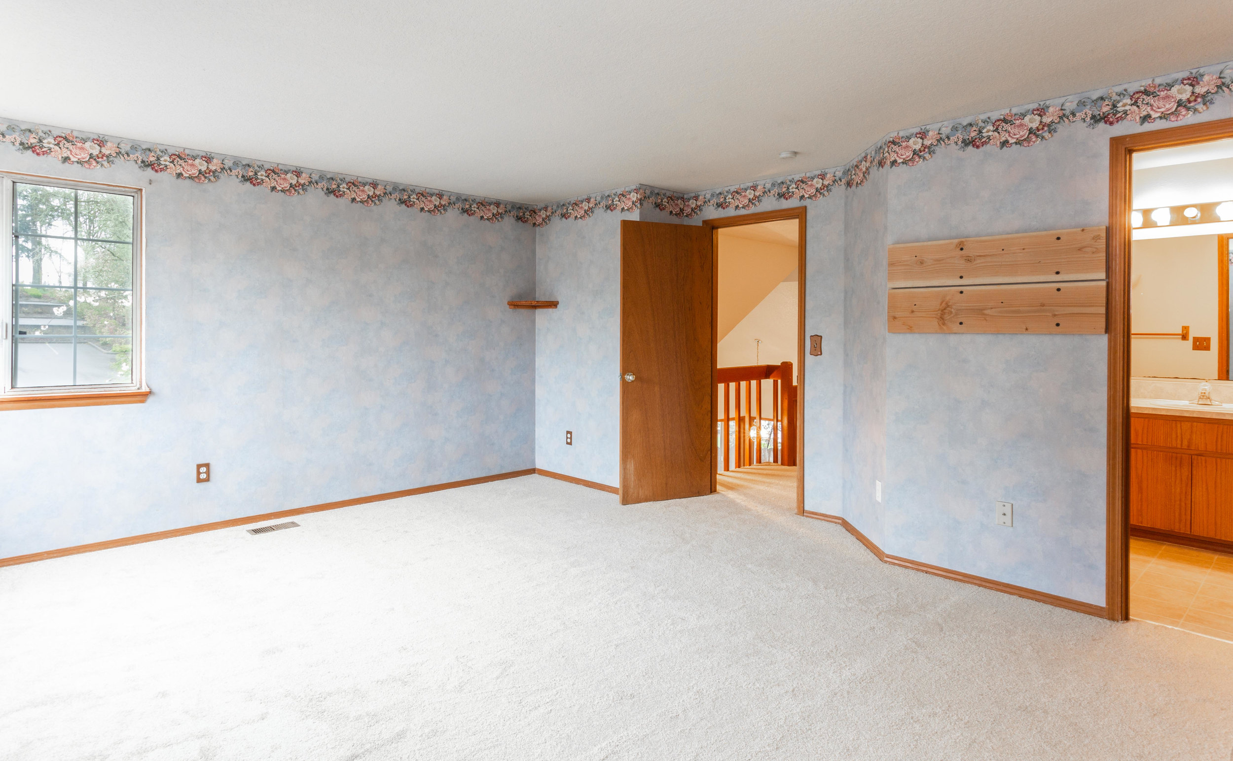 """Okay, so you may not love the wallpaper in the master suite, but you'll want to redecorate this huge 17'x13'7"""" room to be your own private retreat anyway, right?"""