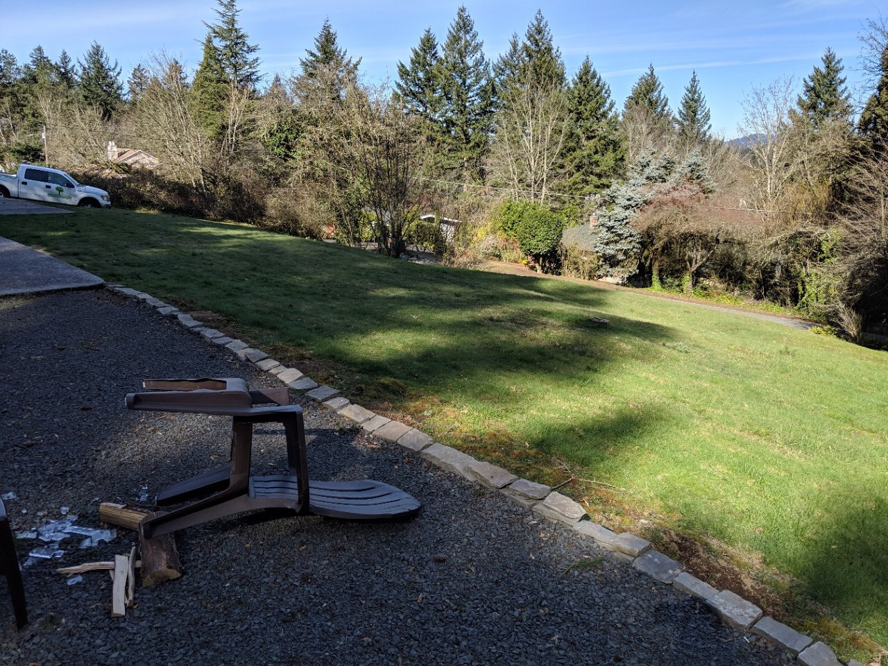 BEFORE: Big grassy sloped front yard (nice woodsy view will remain). Don't worry about the chair. It was windy. We WILL recover.
