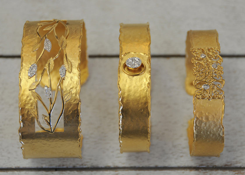 14K yellow gold and diamond cuffs by I. Reiss
