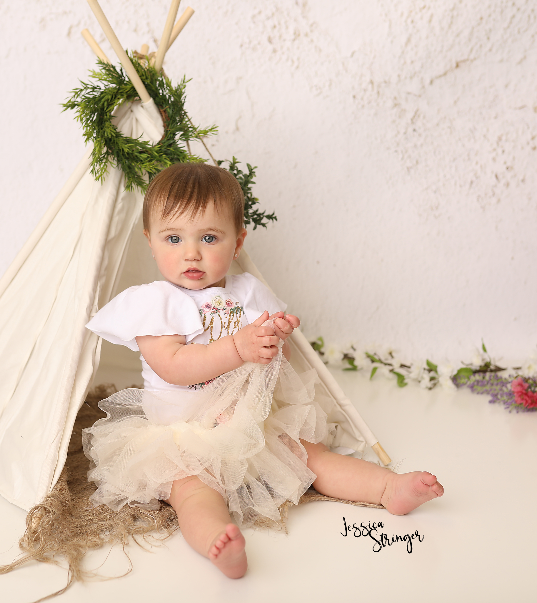https://www.jessicastringerphotography.com/baby-first-birthday/