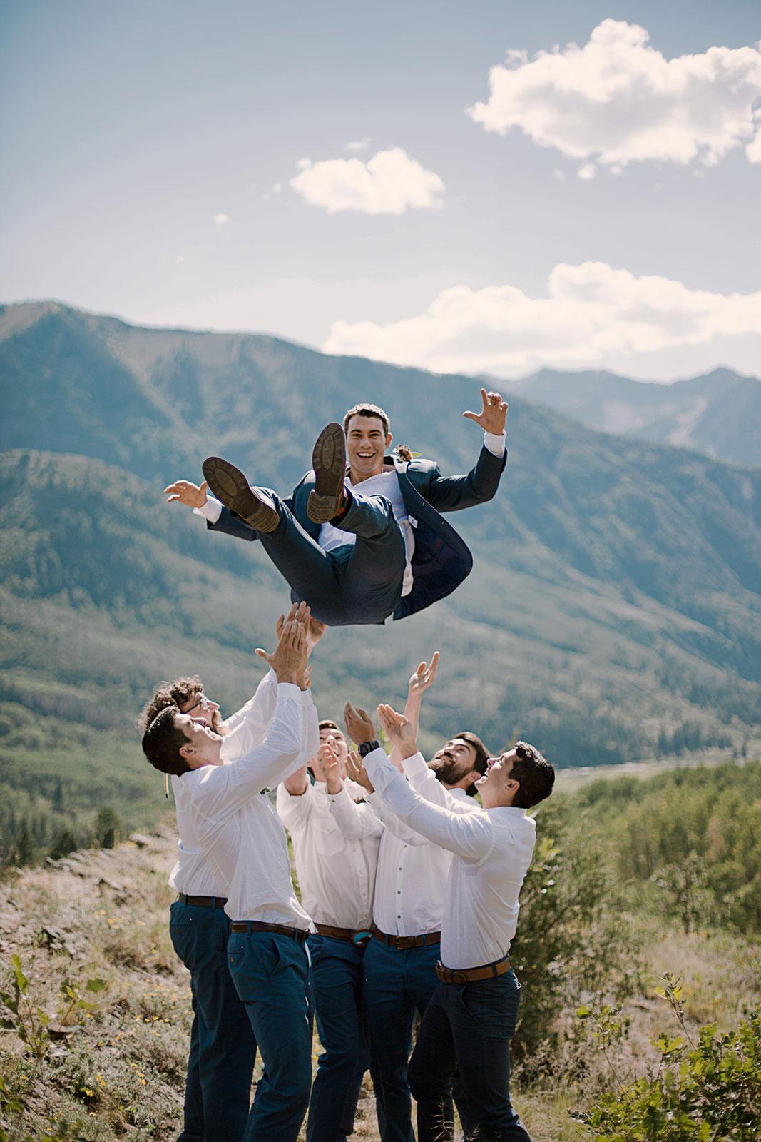 groomsmen tossing groom in the air, adventurous groomsmen, marble lodge wedding, marble colorado wedding, marble colorado wedding photographer, colorado wedding photographer