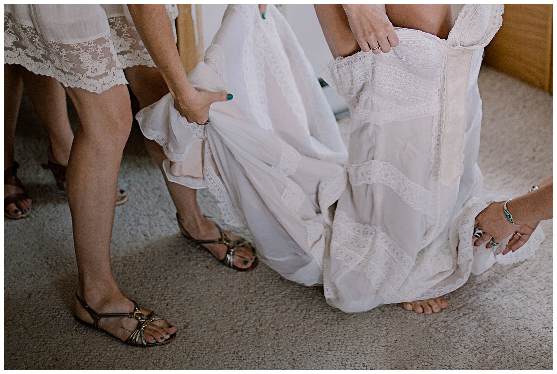 Bride putting on dress, Bride getting ready, intimate colorado wedding photographer, adventurous colorado wedding photographer, marble colorado wedding, marble lodge wedding