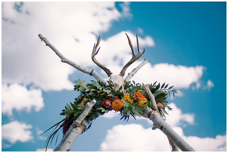 natural wedding arch with florals, wedding details, adventurous colorado wedding photographer, adventure wedding, marble colorado wedding, marble lodge wedding