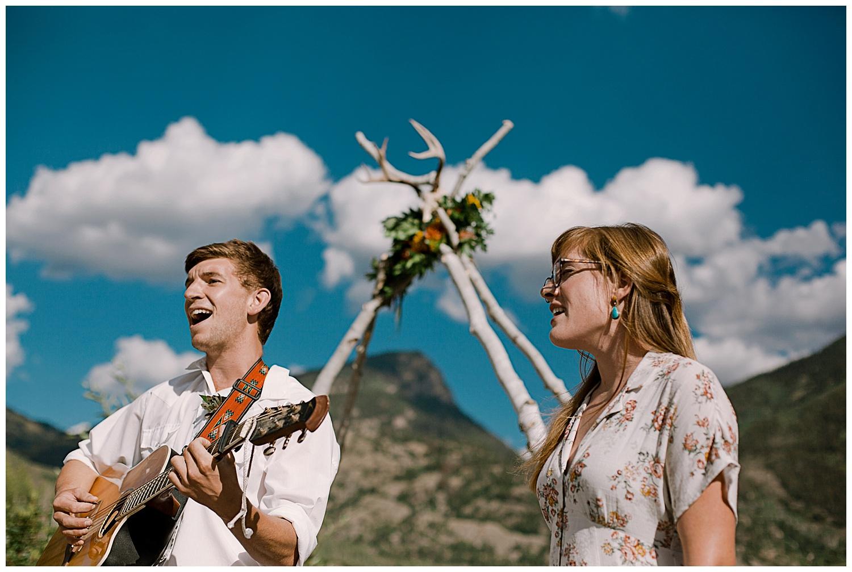 natural wedding arch with florals, outdoor colorado wedding ceremony, marble colorado wedding, marble lodge wedding, adventurous colorado wedding photographer, adventure wedding