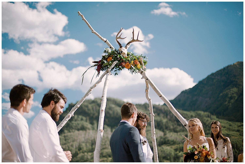 bride and groom at the alter, outdoor colorado wedding ceremony, marble lodge wedding, maroon bells wilderness wedding, marble colorado wedding, adventurous colorado wedding photographer