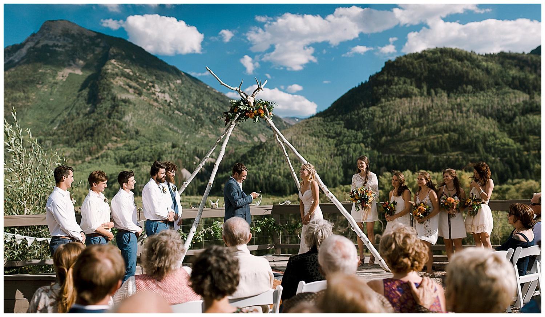 bride and groom saying their vows, outdoor colorado wedding ceremony, marble lodge wedding, maroon bells wilderness ceremony, marble colorado wedding, adventurous colorado wedding photographer