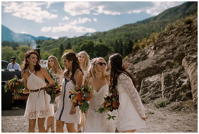 bride and bridesmaids dancing, cocktail hour, outdoor colorado wedding, marble colorado wedding, marble lodge wedding, adventurous colorado wedding photographer